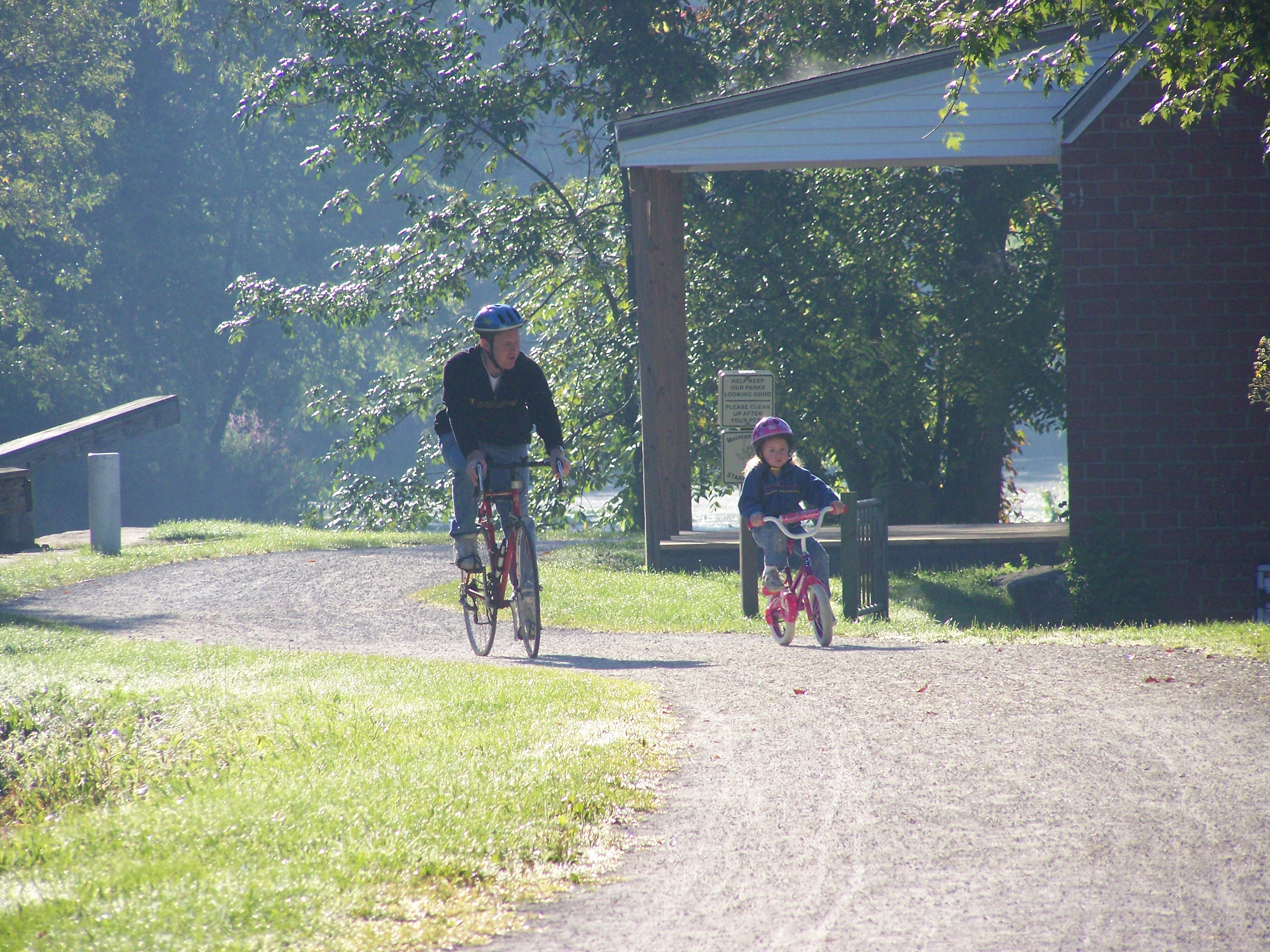 Kaitlyn and I riding our bicycles on the Towpath Trail in Canal Fulton